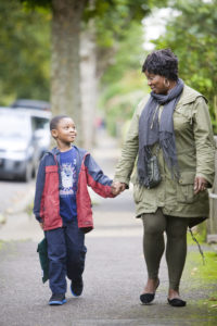 Mother and son walk to school